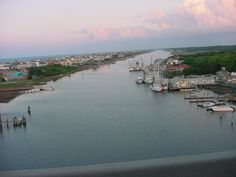 """Holden Beach, NC: What I love about Holden Beach is its low profile. No high-rise hotels, nothing overtly commercial, just a throwback family beach town. Stay on the ocean or """"second row"""" for optimal beach access, or on one of the plentiful canals (pictured here) and bring a blow-up boat for your kids."""
