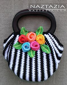 I love this crochet bag. This site has a link to the FREE PATTERN on Ravelry.com