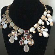 Statement Necklace Clear crystals mixed with soft white and peach crystals makes this a beautiful piece. Because of the neutral colors, this piece can be worn with most wardrobe colors. Jewelry Necklaces