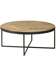 A Large Round Industrial Style Coffee Table. The Minimal Square Section Metal  Frame Supports