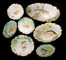Rare 19th C. Tressemanes & Vogt hand painted porcelain 13-piece fish plate set out of Limoges, France.