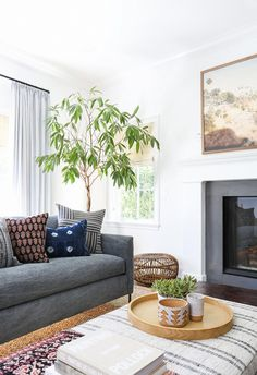 """""""The house is by the beach, so we took the surroundings into account and came up with a neutral palette of blues, greys, and whites,"""" the designer tells us. The aesthetic is East Coast classic..."""