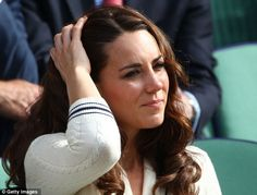 Feeling the pressure: As Murray battled it out in the second set, Kate looked increasingly strained