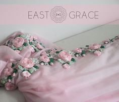 Pink Rose - This ethereal frosted baby #pink #chiffon #saree is adorned with roses on vines along the edges, crafted painstakingly with shades of pink satin #ribbon and sprinkled with glistening #pearls. E&G is coming soon at www.eastandgrace.com. Find us on Facebook: https://www.facebook.com/eastandgrace
