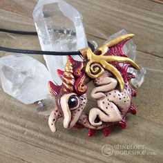 """This red dragon pendant was surprisingly tricky to paint. Getting bright or lighter red highlights is difficult if you don't have a premixed acrylic colour in the tone you want. I ended up having to mix up a """"pink"""" with some white, then glaze over it with a deep red wash instead. Worked like a charm!"""
