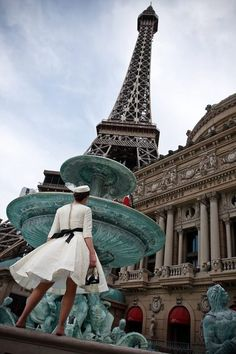 It's unique...there are many pics of eiffel tower, but the pic with girl on white dress and fountain with light blue greenish and brownish red eiffel tower...it's good colour combination...