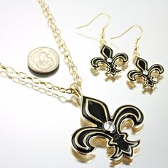 NEW! FLEUR DE LIS NEW ORLEANS SAINTS/BLACK AND GOLD NECKLACE AND EARRING SET WILL LOOK GREAT WITH YOUR OUTFIT . REALLY NICE!  GEAUX SAINTS!!