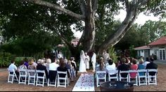 Katie and Peter chose the lush gardens of Shangri-la Springs in Bonita Springs, FL to become Husband and Wife.  Katie's Aunt preformed a beautiful ceremony under the large banyan tree. Their day was planned by Amanda Melymuka with Exclusive Destination Management.  They did a wonderful job making sure all was running smoothly.   The up-lighting provided by Jim Dalia of A DJ with Class transformed the room into a room of elegance.  Jim also provided the ceremony music, as well as, the ...