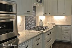 Gorgeous kitchen countertop, tile, and backsplash!  Kitchens that Sizzle from June DeLugas Interiors