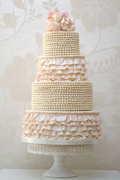 Beads and frills wedding cake with roses by http://rosalindmillercakes.com