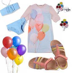 Delizioso e colorato questo outfit pensato per una bambina. Bikini azzurro con voulant, abitino rosa con stampa di palloncini colorati. Sandaletti in pelle colorati, piccoli orecchini con palloncini ed infine un bel fiore di veri palloncini!