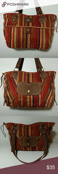 😊👜Women's GROOVY...Large FOSSIL Handbag👜😍 Up for grabs is this really groovy women's large fossil handbag. This handbag is an excellent top-notch preowned condition. It is a very cool bag. It will hold lots of your goodies. Check out my closet for more women's handbags. Thanks for looking. Fossil Bags Shoulder Bags