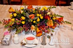#wedding reception decorations #centerpieces #tablescapes #reception details #Michigan wedding #Mike Staff Productions #wedding details #wedding photography http://www.mikestaff.com/services/photography #fall #short centerpieces