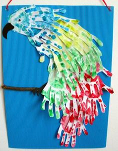 Hand print parrot  Mix and make a hand print after each color mixing lesson? hmm