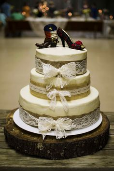 Burlap and lace wedding cake on tree ring and vintage Jack Daniels whiskey barrel. See more rustic wedding ideas at mythreeweddings.com