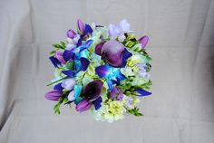 blue orchid with calla lilies