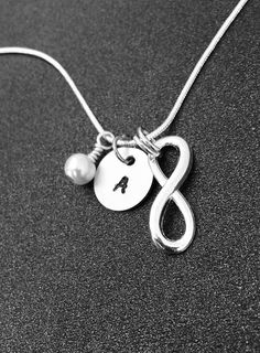 A personal favorite from my Etsy shop https://www.etsy.com/listing/221060769/bridesmaid-necklace-infinity-initial