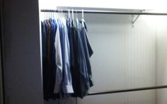 Main part of closet with rods and shelf installed.