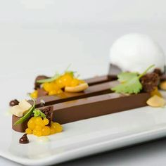 Creation by Chef Michael Laiskonis.  Chocolate, mango, lime, coconut, cashews.