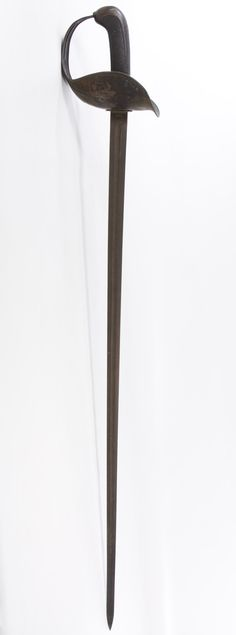 Lot 382: World War I US Patton Calvary Sword; 1918, serial #33862, produced by Springfield Armory; stamped marks on the blade