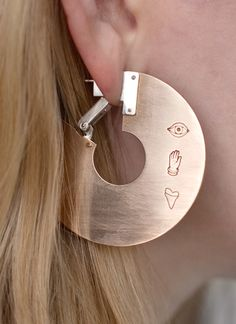 "These ""Thin slice"" earrings are too cool: http://www.autoctona.net/all-products"