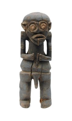 "Cameroon, Africa, Bamileke. Carved wood figure of a standing male. 21""h. 8""w. 7""d."