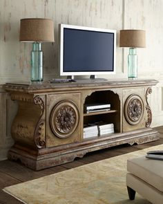"""Entertainment console handcrafted of mixed hard and soft woods including oak. Embellished with hand-carved scrolls and medallions. Hand-painted finish. Two doors and one shelf. 93""""W x 23""""D x 36""""T. Imp"""