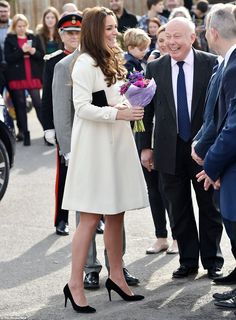 Sharing a joke: The Duchess laughed and chatted with Downton creator Lord Julian Fellowes, whose wife is a lady-in-waiting