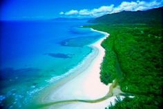 The Daintree Rainforest spills down to the Great Barrier Reef, far North Queensland. Queensland Australia, Australia Travel, Great Barrier Reef Tours, Daintree Rainforest, Australian Beach, Airlie Beach, Beaches In The World, Beautiful World, Simply Beautiful