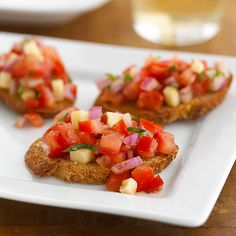 Caprese Bruschetta - A toasted baguette is topped with diced tomatoes ...