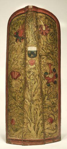 Bemalte große Pavese (Setztartsche) aus Holz, Schweinsleder und Leinwand. Süddeutsch, um 1500. Die Pavese ist 122 cm hoch. (Bayerisches Nationalmuseum München W 398)