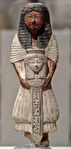 statuette (painted limestone, H.27cm) of a priest holding a standard topped by the Hathor-head. 1539-1076 BCE; now in the Egyptian Museum of Torino…