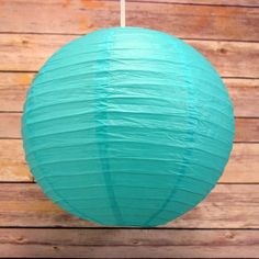 12 Inch Water Blue Hanging Round Paper Lanterns on Sale Now! We offer vintage and unique Wedding Decorations, party supplies, decor, and lighting supplies in Bulk at Wholesale Prices.