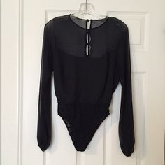 """Vintage Montaldo's Black Chiffon Body Suit Vintage Montaldo's Black Sheer Long Sleeve Body suit.  Size 10 Measurements: 17"""" Chest  20"""" Sleeve Length  12"""" Waist 25"""" Length  Gently worn, excellent condition .                    No trade, no holding, no off sight payment. Montaldo's Tops Blouses"""