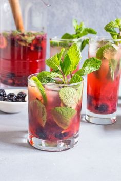 Blackberry Mojito Sangria combines two drinks into one, for a cocktail that is light and fresh for the season. It's filled with plenty of fresh blackberries, mint, lime, a healthy splash of rum and dry white wine.