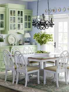 love the colors, the chairs, the cupboards, everything