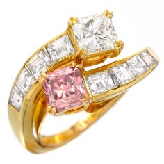 Van Cleef & Arpels, A Colored Diamond Ring, of 'toi et moi' design, the square-shaped Fancy Intense Pink diamond weighing 0.63 carats to the opposing square-shaped diamond, with graduated diamond shoulders to the plain hoop, signed VCA, and numbered 143914. Accompanied by a GIA report stating that the diamond is Fancy Intense Pink, SI2 clarity. c 1990