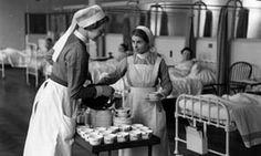 nurses pouring tea into cups for patients at St. Bartholomew's (Bart's) Hospital, London, in 1939, UK