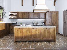 Îlot central en bois avec son plan de travail blanc, ses plaques de cuisson classique et sa hotte de cuisson suspendu dans une cuisine rustique et traditionnelle faite de bois
