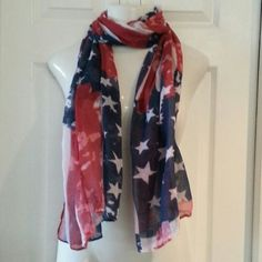 USA American Flag Scarf Rugged pattern Offered in a patriotic American flag scarf. New without tags and in immaculate condition. Pattern is rugged flag. This large scarf  is made of a lightweight fabric . Please check out my other listings for more scarves I love to bundle. Accessories Scarves & Wraps