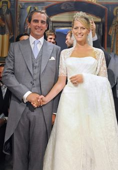 25 Aug 2010 — Prince Nikolaos of Greece & Denmark son of King Constantine & Queen Anne-Marie of Greece) & Miss Tatiana Blatnik, during their wedding ceremony at the Cathedral of Ayios Nikolaos (St. Nicholas) in Spetses, Greece Royal Wedding Gowns, Royal Weddings, Wedding Dresses, Greek Wedding, Wedding Bride, Wedding Ceremony, Celebrity Dresses, Celebrity Weddings, Celebrity Photos