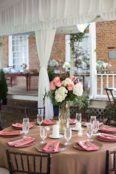 Burlap Table Linens with Pink Napkins and Gorgeous Centerpieces http://busseysflorist.com/wedding-flowers/