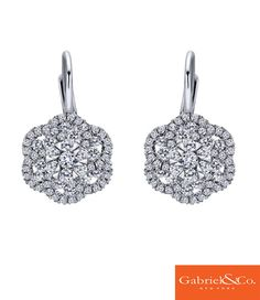 These impeccable 14k White Gold Diamond Drop Earrings by Gabriel and Co. is the perfect way to thank your bridesmaids. Pair this along with your bridesmaid dress to spice and sparkle it up as you walk down the aisle! Catch every guest's attention with these diamond Gabriel & Co. earrings.