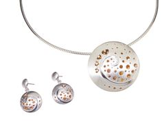 Lovingly hand crafted by goldsmith Fiona Kerr this bespoke pendant and earring set is made in silver & 22ct yellow gold pendant with diamonds, elegant and unique.