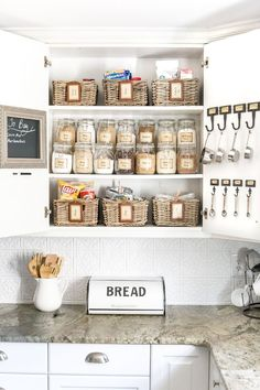 Pantry Cabinet Organization and Printable Labels A cabinet gets a drastic organization makeover using inexpensive IKEA jars / baskets, hanging storage, and a free pantry label printable set. Smart Kitchen, Kitchen On A Budget, Diy Kitchen, Kitchen Decor, Kitchen Ideas, Kitchen Jars, Kitchen Hooks, Kitchen Storage Baskets, Kitchen Designs