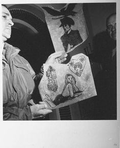 """A Polaroid taken by Margaret Bourke-White during the liberation of Buchenwald of an unknown American soldier showing pieces of the human skin collection that belonged to """"The Beast of Buchenwald,"""" IIse Koch."""