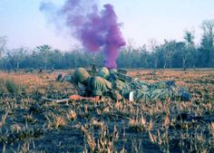 "A ""goofy grape"" purple smoke round is popped up in the bush. Sometimes the NVA also had smoke grenades and would use them to try and confuse the helicopter pilots who may have come in to provide airborne artillery support or extraction. Because of this, helicopter crews would confirm the color of the smoke, and forces on the ground were creative with their description of the color in case the enemy were monitoring their radio transmissions as well."