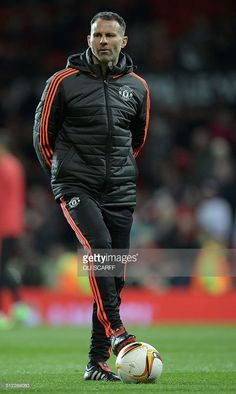 Manchester United's Welsh assistant manager Ryan Giggs watches the players warm up during the UEFA Europa League round of 32, second leg football match between Manchester United and and FC Midtjylland at Old Trafford in Manchester, north west England, on February 25, 2016. SCARFF