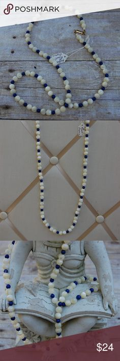 """Custom one of a kind necklace A custom one of a kind natural stone necklace. This Mother of Pearl combined with beautiful blue Lapis stone necklace is a true statement piece. Custom designed and personally hand strung by my late father.This piece was intended to be a part of his newest line of women's accessories. This is one of the sample pieces he created for buyers market shows. Necklace measures 30"""" in length excluding the 1"""" clasp. Gorgeous and perfect for game day or school spirit day…"""