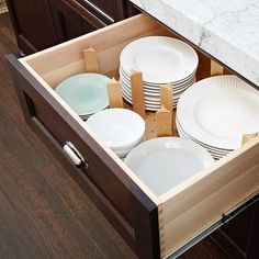 Extra-deep drawers, especially by the range, make cooking and storage effortless. They're more accessible than typical base cabinetry and so simple to integrate into a beautiful kitchen design. Add-ons, like pegboard and drawer organizers, keep drawers tidy and prevent plasticware tumbles.